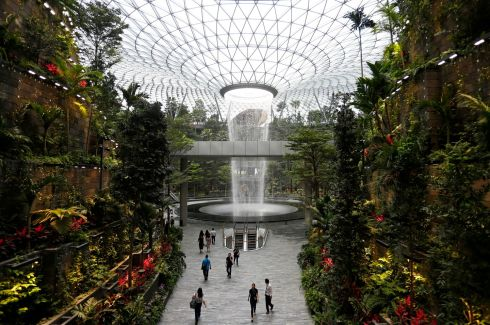 AERIAL DISPLAY: The 40m-high Rain Vortex, which is the world's tallest indoor waterfall, is seen from inside Jewel Changi Airport in Singapore. Photograph: Feline Lim/Reuters
