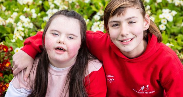 Grace O'Brien (12) and Katelyn Harrington (11), from Pouladuff Road, Cork. Katelyn's book, My Friend Grace, is up for an Aldi Foróige youth citizenship award on Saturday. Photograph: Michael O'Sullivan