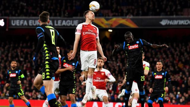 Aaron Ramsey challenges for the the ball with Napoli's Kalidou Koulibaly. Photograph: Neil Hall/EPA