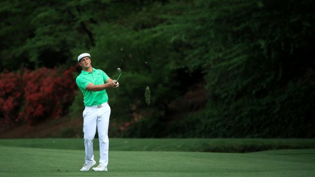 DeChambeau plays his approach to the 13th. Photo: Andrew Redington/Getty Images