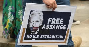A person holds a sign during a rally calling for the release WikiLeaks founder Julian Assange, in Sydney, Australia. Photograph: Peter Rae/EPA.