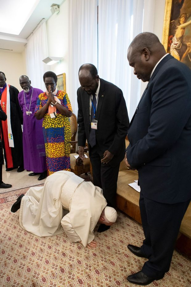 Pope Francis kneels to kiss the feet of South Sudan's president Salva Kiir. Photo Vatican Media/AFP/Getty