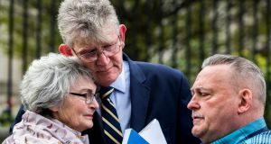 Kate McCausland embraced by Survivors North West Jon McCourt and John Heaney after speaking of her mother Una Irvine outside Belfast's High Court after a failed bid to force the Northern Ireland Secretary of State Karen Bradley to compensate victims of historical sexual abuse. Photograph: Liam McBurney/PA Wire