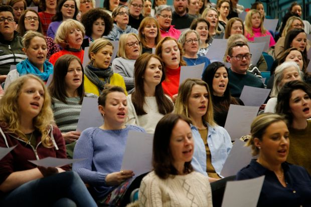 Members of the choir read from hymm sheets. Song selections comes from a range of genre including classics from the 1980s and 1990s right up to modern pop, rock and R&B tracks. Photograph Nick Bradshaw for The Irish Times
