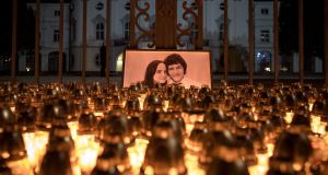 Candles  placed during a march in memory of murdered Slovak journalist Jan Kuciak and his fiancee Martina Kusnirova, in front of the Slovak government building in Bratislava on February 28th last year. Photograph: Matej Kalina/EPA