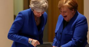 UK prime minister Theresa May and German chancellor Angela Merkel during a lighter moment at the start of this week's emergency summit in Brussels. Photograph: Kenzo Tribouillard/Reuters