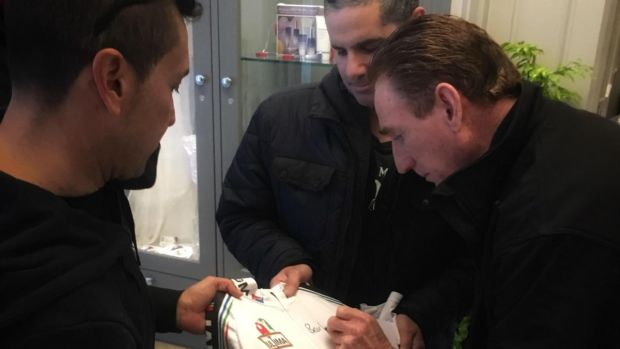 Seán Kelly signs a PDM cycling jersey for Italian fans at the Rose Hotel in Tralee