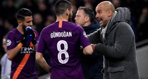 Manchester City's head coach Pep Guardiola (right) gives instructions to  Ilkay Guendogan  during the UEFA Champions League quarter final first leg match between Tottenham Hotspur and Manchester City at Hotspur Stadium in London on April 9th. Photograph: Neil Hall/EPA