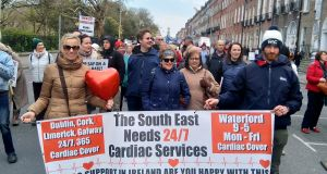 Protesters march in Dublin over cardiology services in Waterford.