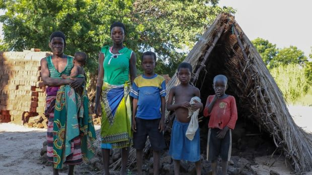 Malita (45) with her baby Joana (nine months), daughter Salah (20) and sons Isaki (11), Eversi (9) and Dalitzo (6) beside what is left of their home in Nsanje, Malawi, after the floods. Photograph: Gavin Douglas/Concern Worldwide.