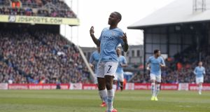 Raheem Sterling celebrates after scoring Manchester City's second against Crystal Palace. Photograph: Adrian Dennis/AFP/Getty
