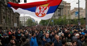A Serbian flag held aloft during a protest march against President Aleksandar Vucic in Belgrade on Saturday. Photograph: Darko Vojinovic