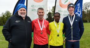Athletics Ireland deputy president John Cronin (L) with mens medallists Declan Reed (bronze),  Hiko Tonosa (gold) and Kevin Dooney (silver). Photograph: Sam Barnes/Sportsfile