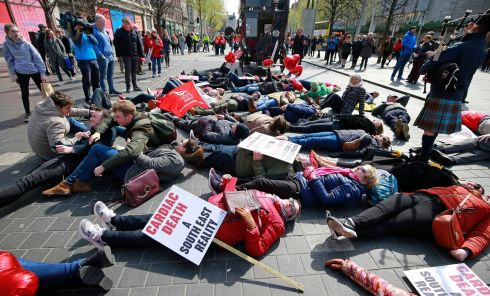 PROTEST: Demonstrators lie in the centre of O'Connell Street, Dublin as part of the march for Health Equality in the South East which gathered at the Garden of Remembrance on Saturday afternoon. Photograph: Nick Bradshaw/The Irish Times