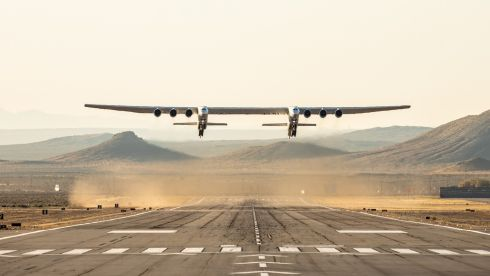 TAKE OFF: The Stratolaunch aircraft lifts off from the ground during a test flight in Mojave, California, on Saturday. The Stratolaunch, the world's largest aircraft by wingspan, successfully completed its first test on April 13th. The plane, which has been eight years in the making, is designed to act as a flying launch pad for satellites. During the test flight it reached a maximum speed of 304km/h at altitudes up to 5181.6m. Photograph: Stratolaunch/Handout/EPA