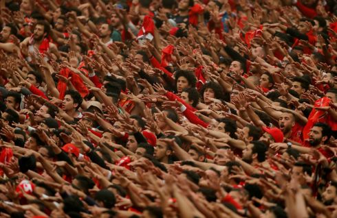 HANDS UP: Fans react during the quarter final second leg fixture of the African Champions League between Al-Ahly and Mamelodi Sundowns at the Borg El Arab Stadium in Alexandria, Egypt on April 13th. Photograph: Amr Abdallah Dalsh/Reuters