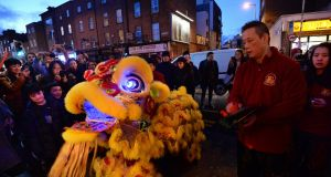 Lion dance performance on Parnell Street, Dublin, as part of the Dublin Chinese New Year Festival in 2018. Photograph: Dara Mac Dónaill