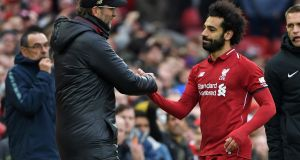 Liverpool forward Mohamed Salah  celebrates with manager   Jurgen Klopp    as he's substituted after scoring a goal against Chelsea to give his side a 2-1 victory. Photograph: Getty Images