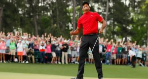 Tiger Woods celebrates after sinking his putt on the 18th green to win the Masters at Augusta. Photograph: Kevin C Cox/Getty