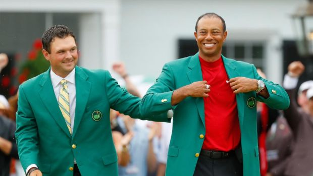 Tiger Woods is awarded the Green Jacket by Masters champion Patrick Reed after winning the Masters at Augusta National Golf Club on Sunday. Photograph: Kevin C Cox/Getty Images