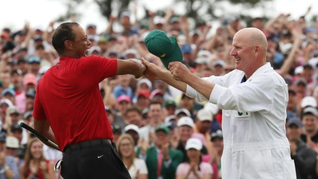 Tiger Woods celebrates with caddie Joe LaCava on the 18th hole after winning the US Masters at Augusta, Georgia, on Sunday. Photograph: Jonathan Ernst/Reuters