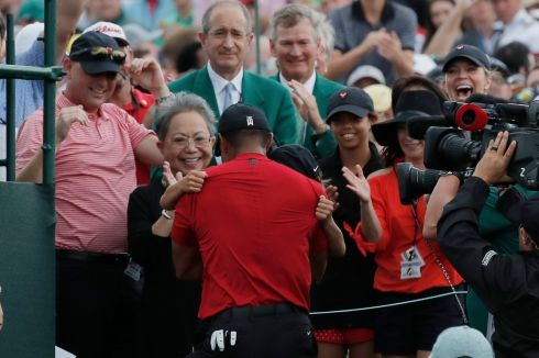 Tiger Woods embraces his son Charlie Axel as his mother Kultida Woods, daughter Sam Alexis and girlfriend Erica Herman look on. Photograph: Reuters