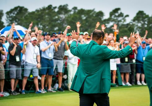 Tiger Woods wears the green jacket in a ceremony after winning the Masters. Photograph: Doug Mills/The New York Times