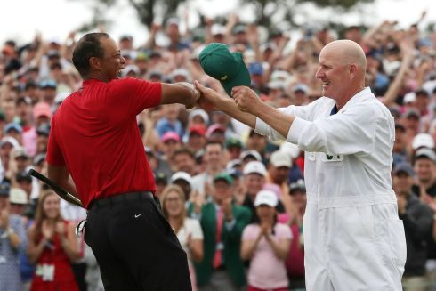 Tiger celebrates with caddie Joe LaCava on the 18th hole. Photograph: Reuters