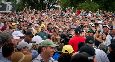Tiger Woods walks through the crowd on a famous day for golf. Photograph: Doug Mills/The New York Times