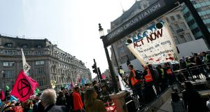 Climate change activists demonstrate at Oxford Circus in London on Monday. Photograph: Peter Nicholls/Reuters