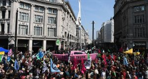 Environmental protesters  gather at the junction of Oxford Street and Regent Street in London on Monday. Photograph: Daniel Leal-Olivas/AFP/Getty Images