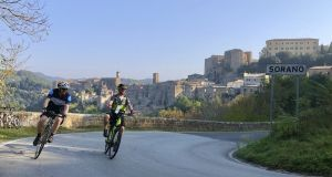 Riders take to the road with e-bikes during a tour in Italy. E-bikes have motors run by batteries to help riders go up hills, and that can be a boon for tour companies who can accommodate slower riders. Photograph: Experience Plus! Bicycle Tours via The New York Times
