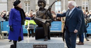 The Higginses unveil John Coll's statue of legendary Dubliner Luke Kelly, also on January 30th, in Dublin 2. Photograph: Dara Mac Donaill