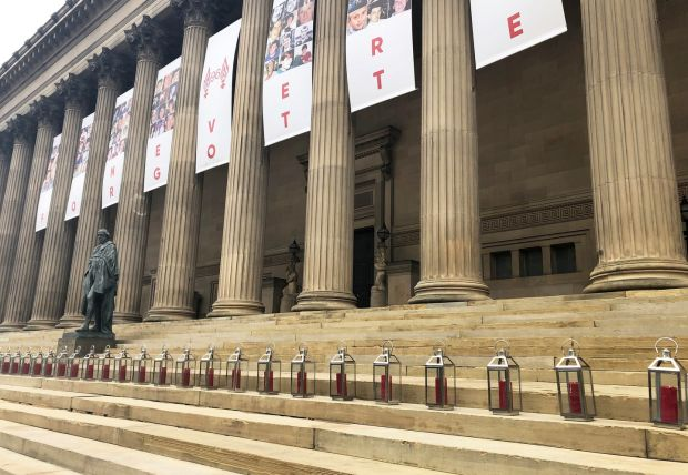 Some of the 96 lanterns that were lit on the steps of St George's Hall in Liverpool, one for each of the victims of the disaster. Photograph: Eleanor Barlow/PA Wire