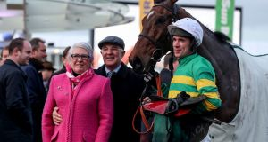 Trainer Ted Walsh and his wife Helen celebrate Any Second Now's  victory in the Kim Muir Chase at Cheltenham  with  jockey Derek O'Connor. Photograph: Dan Sheridan/Inpho