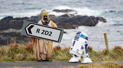 MAY THE ROADS BE WITH YOU: Adrian Hanna, dressed as a Tusken Raider from Star Wars, poses with an R2D2 replica built by himself and his son Jack, at the renaming of the R 2D2 road in Malin Head, Co Donegal, ahead of the Malin Head Star Wars Festival. Photograph: Niall Carson/PA Wire