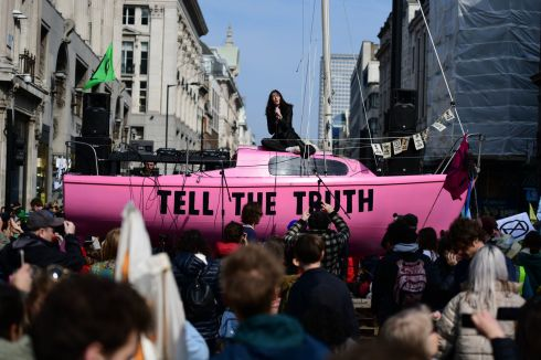 EXTINCTION REBELLION: Jessica Winter sings on a boat in the centre of a traffic junction as environmental campaigners block Oxford Circus in London during a coordinated protest by the Extinction Rebellion group, who aim to stop traffic for up to five days in locations across the city. Photograph: Leon Neal/Getty