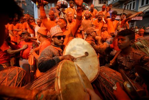 SINDOOR JATRA: Devotees play traditional musical instruments while celebrating the Sindoor Jatra festival, in which vermillion powder is flung about, at Thimi, Bhaktapur, Nepal. The festival marks the Nepalese New Year and the beginning of the spring season. Photograph: Navesh Chitrakar/Reuters