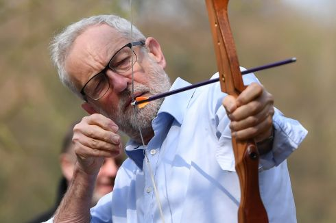 LET IT GO: British Labour leader Jeremy Corbyn tries his hand at archery at the Sunnyvale Outdoor Activity Centre in Halifax, England. Mr Corbyn was in Yorkshire to visit a youth crime reduction centre. Photograph: Anthony Devlin/Getty