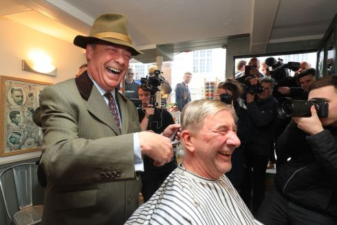 BEYOND UKIP: Former Ukip party leader Nigel Farage visits a barber shop in Shoreham, West Sussex, during a walkabout ahead of a rally for his new Brexit Party at Brighton City Airport. Photograph: Gareth Fuller/PA Wire
