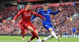 Jordan Henderson  and Chelsea's Andreas Christensen in action  during the Premier League match at Anfield, Liverpool. Photograph: Peter ByrnePA