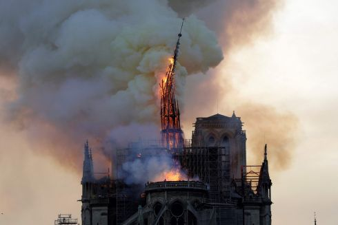 The spire of the cathedral collapses during the blaze. Photograph: Geoffroy Van Der Hasselt/AFP/Getty