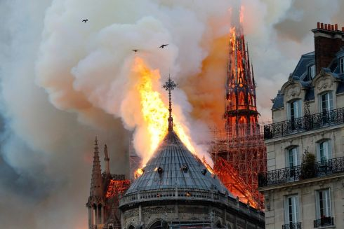 The roof Notre Dame cathedral is swallowed by flame. Photograph: Francois Guillot/AFP/Getty