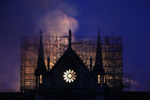 Smoke and flames rise during through  Notre Dame cathedral in Paris on Monday, potentially involving renovation works being carried out at the site, the fire service said. Photograph: Ludovic Marin/AFP/Getty