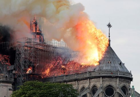 Flames engulf the roof of the cathedral. Photograph: Ian Langsdon/EPA