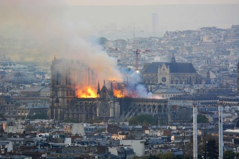 Dark smokes ascends over the French capital during the fire. Photograph: Hubery Hitier/AFP/Getty Images