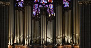 "There are fears about the fate of the extraordinary three ""rose"" stained glass windows in Notre Dame cathedral and the master organ. Photograph: Godong/Universal Images Group via Getty Images"