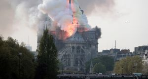 Flames on the roof of the Notre Dame cathedral in Paris on Monday. Photograph:Ian Langsdon/EPA