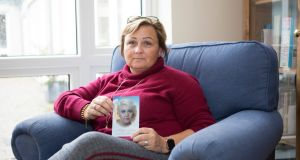 Michelle Walsh holds a photograph of her late daughter, Hollie Gilson. Photograph: Liam Burke/Press 22
