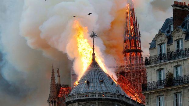 Smoke and flames rise from the Notre Dame cathedral in central Paris. Photograph: Francois Guillot/ AFP/Getty Images